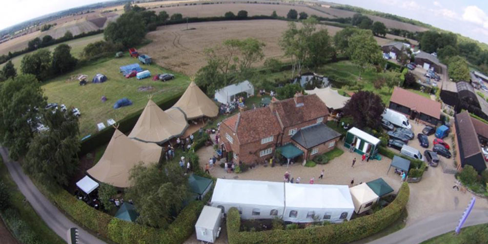 Birds eye photo of festival in a village