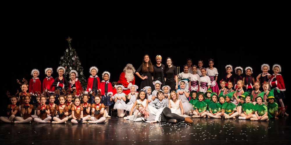 20+ children sat on stage in costumes