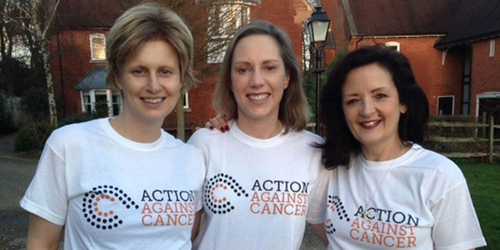 Photo of 3 ladies smiling in AAc t-shirts